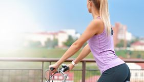 Young female biker on her bike in a city Royalty Free Stock Photo