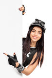 Young female biker pointing on a signboard Stock Photos