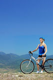 A young female biker posing with a mountain bike Stock Image