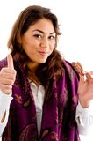 Young female with biscuit and thumbs up Royalty Free Stock Photo