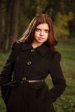 Young female in black coat Royalty Free Stock Photos
