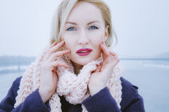 Young female blonde who wears a big bouffant scarf Stock Photography