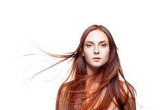 Young female with blowing hair on white Royalty Free Stock Images