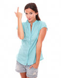 Young female in blue blouse pointing up Royalty Free Stock Image