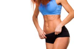 Young female body in fitness sports clothing. Athletic woman. isolated on white background. abs stock image
