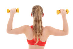 Young female bodybuilder over white Royalty Free Stock Photography