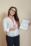 Young female bookkeeper shows accounting documents Royalty Free Stock Images