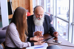 Young female boss argue old employee discuss problems in busines Royalty Free Stock Image