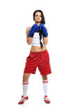 A young female boxer in blue gloves Royalty Free Stock Images