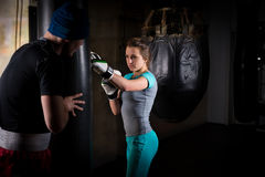 Young female boxer in boxing gloves training with her couch and royalty free stock photography