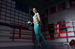 Young female boxer with boxing gloves training and prepares for Royalty Free Stock Image