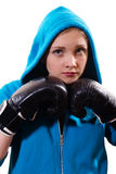 Young female boxer in gloves and hoodie Royalty Free Stock Images