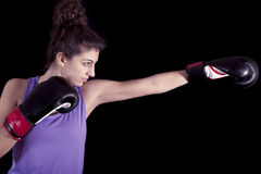 Young female boxer hits during a workout Royalty Free Stock Image