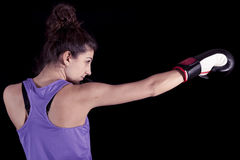 Young female boxer hits during a workout Stock Photography
