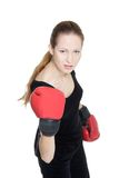 Young female boxer over white Royalty Free Stock Image