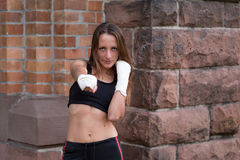 Young female boxer working out Royalty Free Stock Images