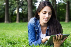 Young female browsing on digital tablet Royalty Free Stock Photography