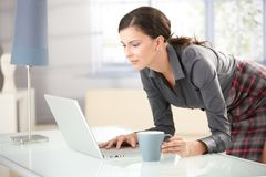 Young female browsing internet at home Stock Photo
