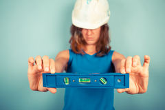 Young female buidler holding a level stock photos