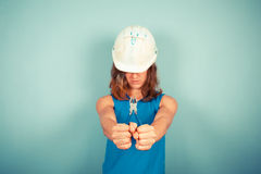 Young female builder holding pliers royalty free stock photos