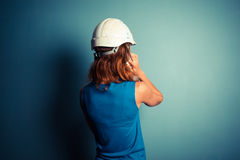 Young female builder on the phone Royalty Free Stock Image