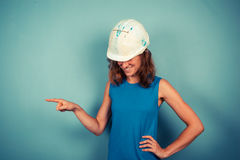 Young female builder pointing royalty free stock images