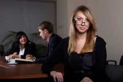 Young female businesswoman in office Stock Images