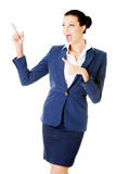 Young female businesswoman pointing up. Royalty Free Stock Photos
