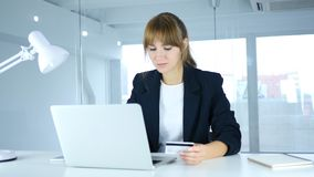 Young Female Busy in Online Shopping, Payment by Credit Card. 4k , high quality Royalty Free Stock Photography
