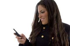 Young female busy reading text message Stock Photos