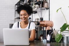 Young female cafe owner stock photography