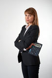 Young female with a calculator in her hand Stock Image