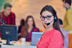 Young female in call center team. Beautifull Young female in call center team royalty free stock image