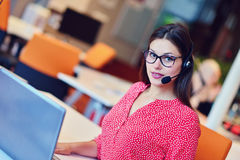 Young female in call center team Stock Images