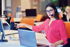 Young female in call center team Stock Photo