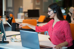 Young female in call center team. Beautifull Young female in call center team royalty free stock photos