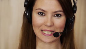 Young female call centre agent stock video