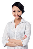 Young female call centre executive Stock Image