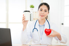 Young female cardiology doctor face to camera Royalty Free Stock Photos