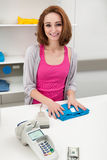Young Female Cashier With Cash Register Stock Photos