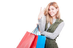 Young female in casual clothes carrying shopping bags Stock Photos