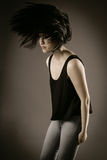 Young Female in Casual Outfit Flipping her Hair Royalty Free Stock Image