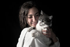 Young female with cat Stock Image