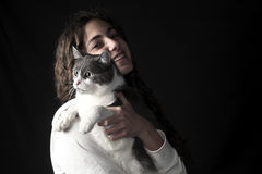 Young female with cat Stock Photos