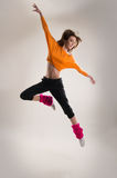 A young female Caucasian dancer in sporty clothes Royalty Free Stock Photo