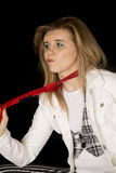 Young female caucasian model pulling on a mens red tie Stock Photo