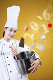 Young female chef cook a meal Stock Photos