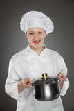 Young female chef  with pot Stock Images