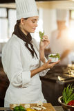 Young female chef smelling herb Stock Photos
