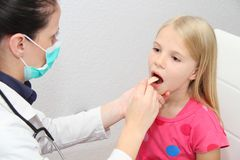 Young female child examined by woman doctor Stock Images